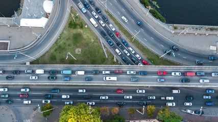 Aerial top view of road junction from above, automobile traffic and jam of many cars, transportation concept  Fotomurales