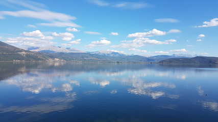 clouds lake blue color reflection autumn in lake Pamvotis Ioannina