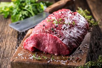 Beef Steak. Raw beef steak. Big Rib Eye steak on wooden board with herb salt and pepper.