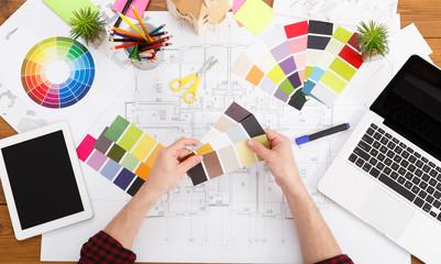 Interior designer working with palette top view