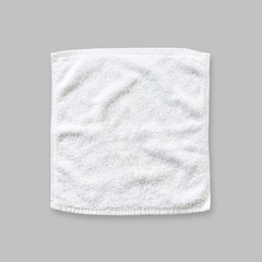 White cotton towel mock up template square size isolated on grey background with clipping path, flat lay top view
