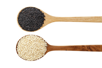 Black and white sesame on wood spoon isolated on white background