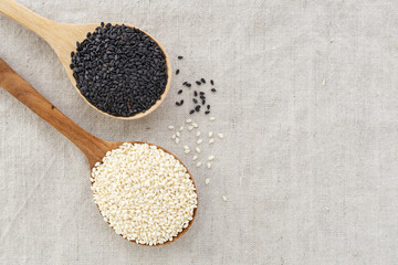 Black and white sesame in wood bowl background with space