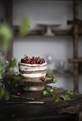 Naked chocolate cake with cherries