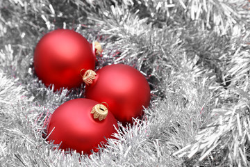 Red christmas balls on silver tinsel