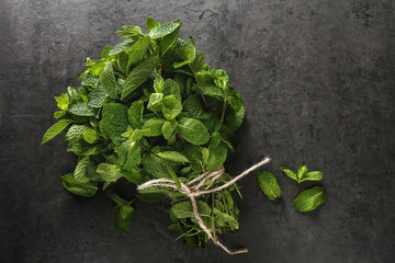 Fresh mint leaves. Italian herbs. Dark background.
