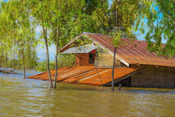 Floods damaged houses. When Tropical Storm And the floods hit Thailand. South East Asia Myanmar Burma Cambodia Cambodia Malaysia Indonesian Philippines Philippines