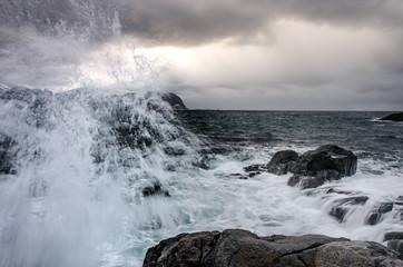 Splashing water on the wild coast of the Lofoten Islands