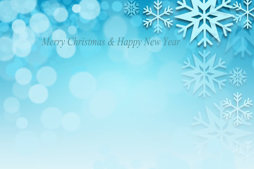 Abstract Christmas bokeh background with blue snowflakes.