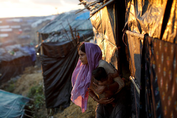Shunsun Nahar, a 20-year-old Rohingya refugee, sits outside her makeshift tent at a refugee camp near Cox's Bazar