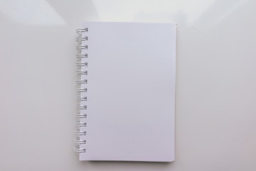 Open Notepad with a blank sheet of paper on a white background. Top view
