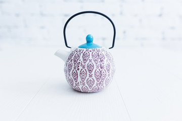 Elegant Chinese style tea pot with a beautiful pattern.