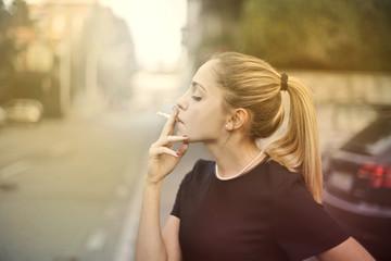 Blonde girl smoking a cigarette