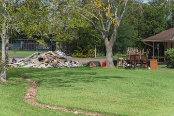 Devastation of Hurricane Harvey in Pearland, Texas, USA with pile of debris from flooding damaged. Huge heap of throw away belongings, materials garbage of ruined houses.