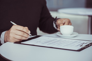 Business Person Signing Contract