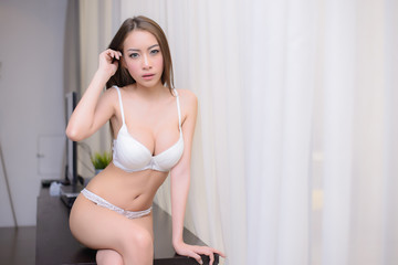 Portrait of beautiful asian sexy woman with white lingerie