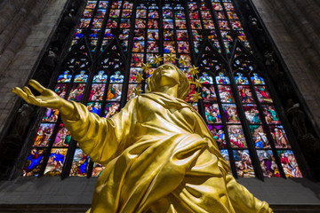 Golden madonnina statue inside Milan Cathedral