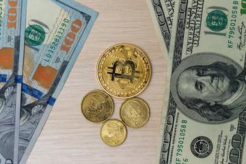 Coins Of Dollars Euros Bitcoins Lying On A Hundred Dollar Bill