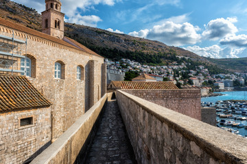 Ancient stone wall of Dubrovnik Old Town, stunning fortification system. The world famous and most visited historic city of Croatia, UNESCO World Heritage site