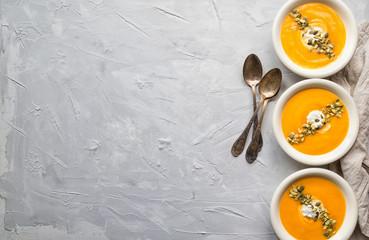 Squash soup on gray concrete background