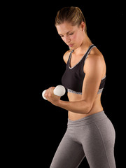 Sporty girl holding weights. Fitness gym concept.