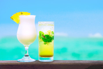 two delicious fruit cocktails by the beach