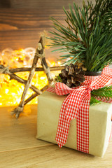 A box with a Christmas present, decorated with natural materials. Christmas decor in eco-style. Selective focus. Vertical.
