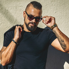 Fashion portrait of handsome brutal man in sunglasses