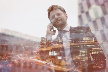 Low angle view of smart businessman talking on mobile phone