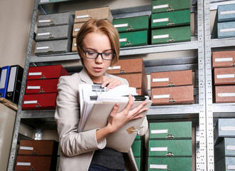 Woman with documents in archive