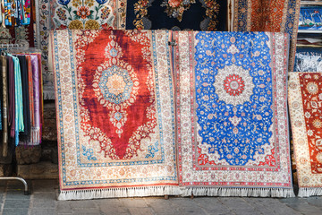 Two colorful silk carpets and rugs at the store in Istanbul Bazar, Turkey