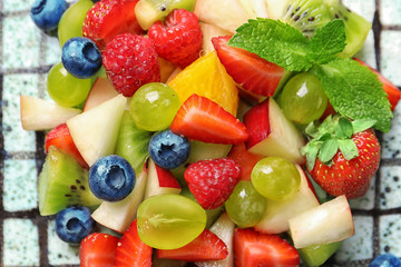 Plate with fruit salad, closeup Wall mural