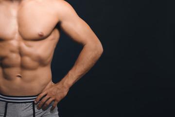 Muscular man on dark background