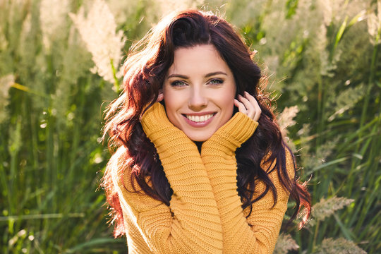 portrait of a beautiful woman in an autumn yellow sweater.