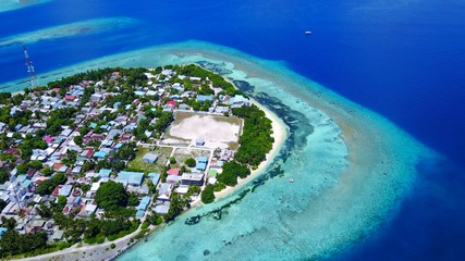 P01111 Aerial flying drone view of Maldives white sandy beach on sunny tropical paradise island with aqua blue sky sea water ocean 4k