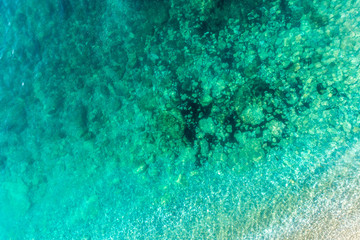 Aerial view of the rocky bottom of the Adriatic Sea covered with turquoise water