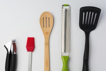Garlic Press Brush Spoon Spatula Zester on White Background Cropped