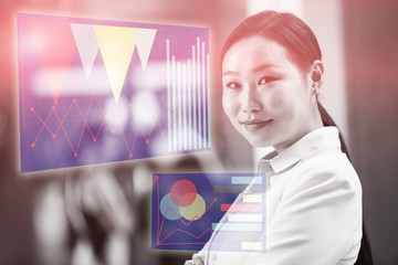 Composite image of asian woman against virtual graph