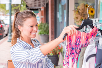Young woman shopping for cloths outside