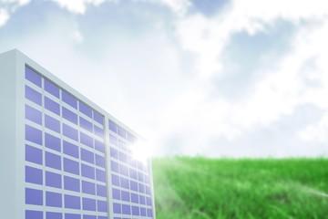 Composite image of solar panel against green landscape