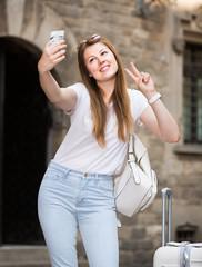 Charming woman tourist making selfie