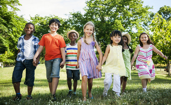 Group of diverse kids having fun together in the park