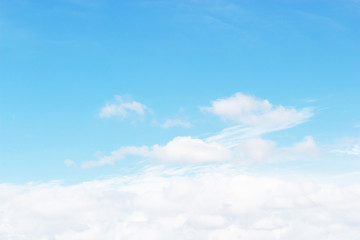 Soft white clouds against blue sky background and empty space for your design, beautiful of nature.
