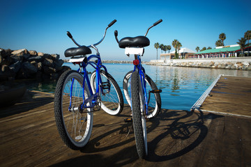 Two bikes on a pier.