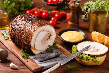 Rolled, roasted pork belly.
