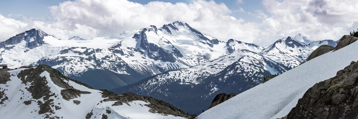 Powerful Mountain Peak Landscape Framed by Snow Covered Rocky Terrain