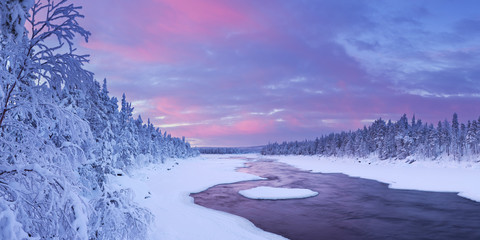 Wall Mural - Sunrise over river rapids in winter, Finnish Lapland