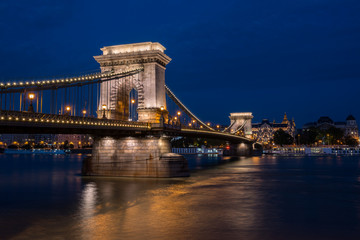 Beautiful night shot of the illuminated Chain Bridge in Budapest across the Danube river in Hungary.