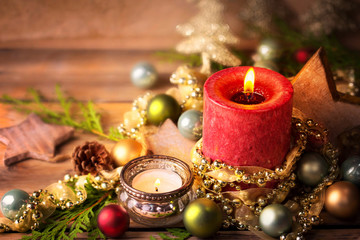 Christmasbackground, advent decoration with burning candles on rustic wooden table