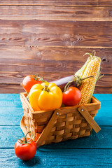 Photo of wooden basket with autumn vegetables